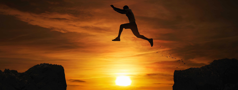 Man jumping between high points